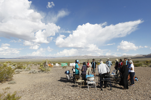 Anti-nuclear weapons demonstrators gather outside the Nevada National Security Site during a civil disobedience action marking the United Nations International Day of Peace Sunday, Sept. 21, 2014. ...