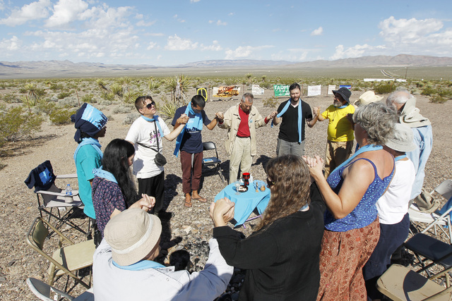 Anti-nuclear weapons demonstrators pray outside the Nevada National Security Site during a civil disobedience action marking the United Nations International Day of Peace Sunday, Sept. 21, 2014. F ...