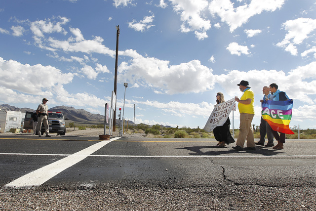 Anti-nuclear weapons demonstrators approach the Nevada National Security Site during a civil disobedience action marking the United Nations International Day of Peace Sunday, Sept. 21, 2014. Fourt ...