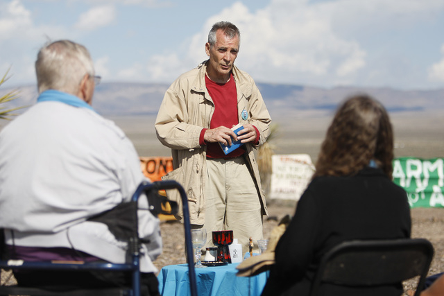 Steve Kelly says Mass for anti-nuclear weapons demonstrators outside the Nevada National Security Site during a civil disobedience action marking the United Nations International Day of Peace Sund ...