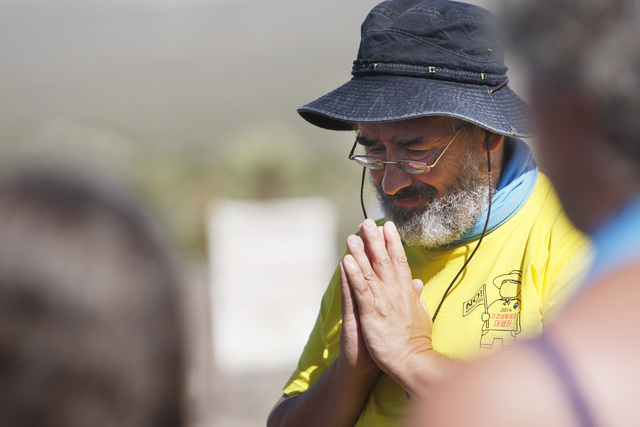Brian Terrell from Maloy, Iowa, prays with other anti-nuclear weapons demonstrators outside the Nevada National Security Site during a civil disobedience action marking the United Nations Internat ...