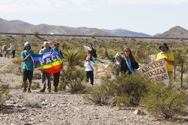 Anti-nuclear weapons demonstrators march through the desert toward the Nevada National Security Site during a civil disobedience action marking the United Nations International Day of Peace Sunday ...