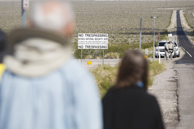 Anti-nuclear weapons demonstrators march toward the Nevada National Security Site during a civil disobedience action marking the United Nations International Day of Peace Sunday, Sept. 21, 2014. F ...