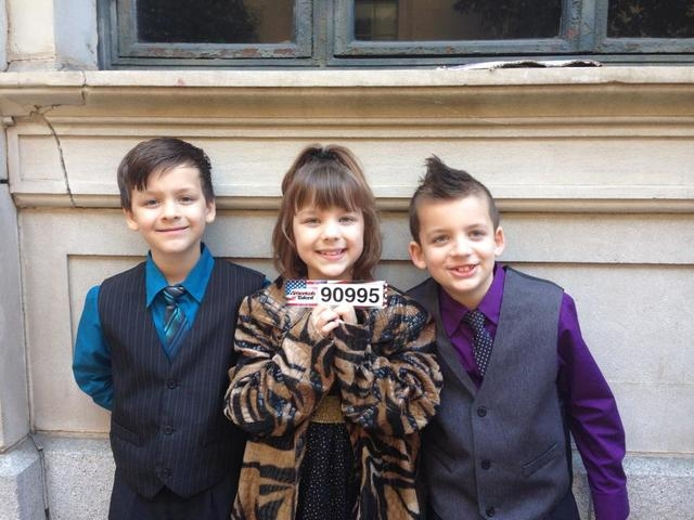 """Dominic, Lyric and Pheonix Evans hold up their audition number for """"America's Got Talent."""""""