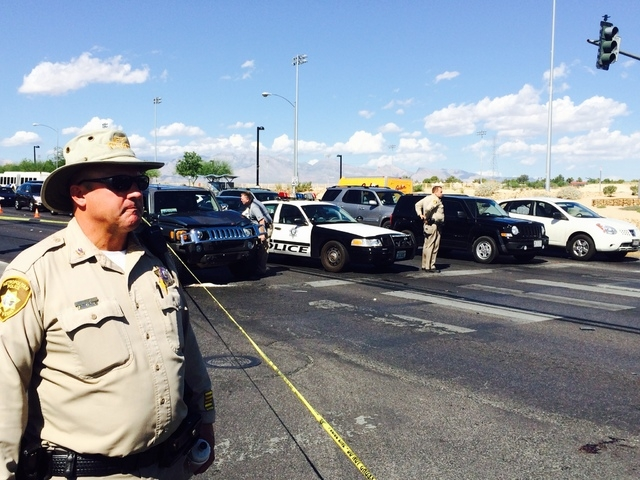 Las Vegas police officers investigate an accident on Friday, Sept. 26, 2014, in the 4900 block of Tropicana Avenue, near Decatur Boulevard. A man was struck by a car, Las Vegas police said, and wa ...