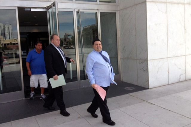 Charles Pecchio, right, as he leaves the federal courthouse Wednesday, Apr. 9, 2014, with his lawyer Chris Rasmussen after pleading guilty in a betting scheme at the Palms resort. (Jeff German/Las ...