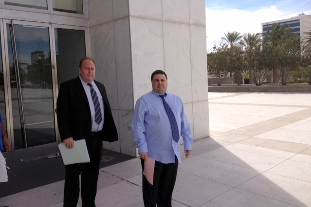 Charles Pecchio, right, stands outside the federal courthouse Wednesday, Apr. 9, 2014, with his lawyer Chris Rasmussen after pleading guilty in a betting scheme at the Palms resort. (Jeff German/L ...