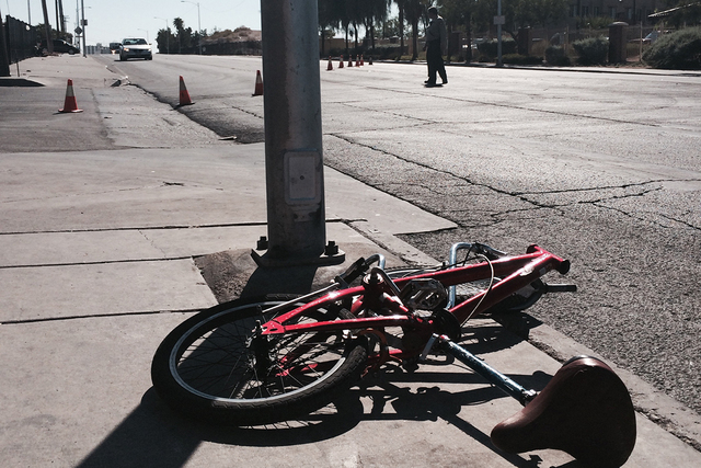 Traffic in the area of Main Street and Foremaster Lane is shut down while police investigate a vehicle-versus-bicycle accident near the intersection. (Bizuayehu Tesfaye/Las Vegas Review-Journal)