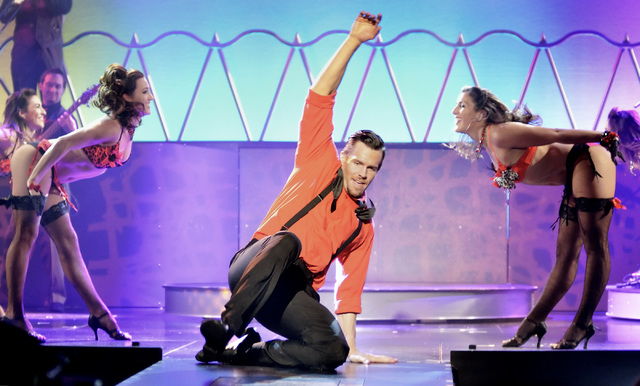 """Ryan Kelsey slides during a dance number for """"Pin Up"""" at the Stratosphere at 2000 Las Vegas Blvd. South, on Thursday, Aug. 21, 2014. (Bill Hughes/Las Vegas Review-Journal)"""