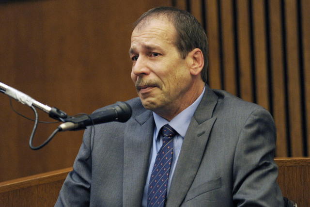 In this Aug. 4, 2014 file photo, Theodore Wafer, of Dearborn Heights, Mich., testifies in his own defense during his trial for the Nov. 2, 2013, killing of Renisha McBride in Detroit. Wafer was se ...