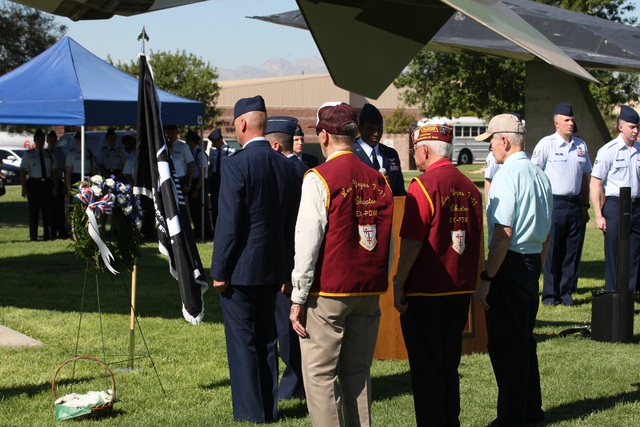 Members of the Las Vegas 7-11 Chapter of American Ex-Prisoners of War observe a wreath placed by Col. Thomas Dempsey during a ceremony Friday, Sept 19, 2014, at Nellis Air Force Base to remember p ...