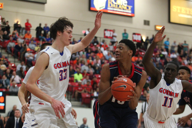 Findlay Prep's Justin Jackson (15) looks to pass as Bishop Gorman's Stephen Zimmerman (33) and Obim Okeke (11) reach to block during a game at the South Point Arena on Saturday, Jan. 25, 2014. Jac ...