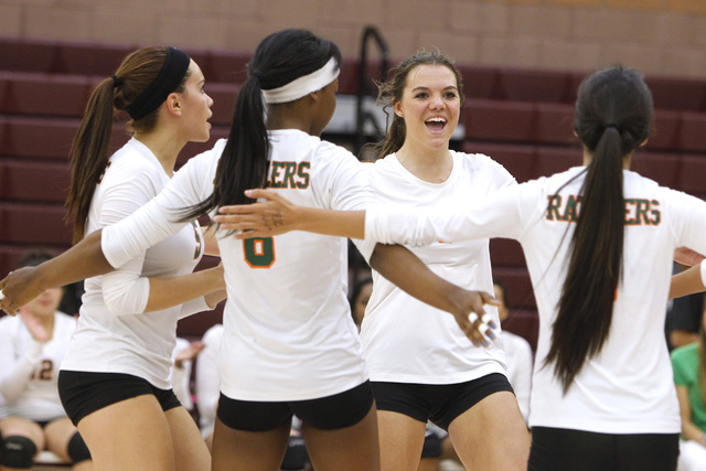 From left, Mojave Girls Volleyball players RayEna Rael, Kristina Gomez, Shyanne Orton and Leilani Limtiaco celebrate a point during their game against Faith Lutheran Thursday, Sept. 18, 2014 at Fa ...