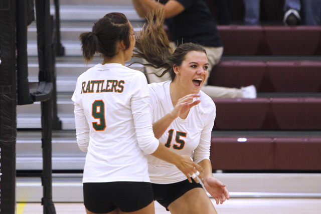 Mojave Girls Volleyball players Allison O'Neill, left, and Shyanne Orton celebrate a point during their game against Faith Lutheran Thursday, Sept. 18, 2014 at Faith Lutheran in Las Vegas. (Sam Mo ...