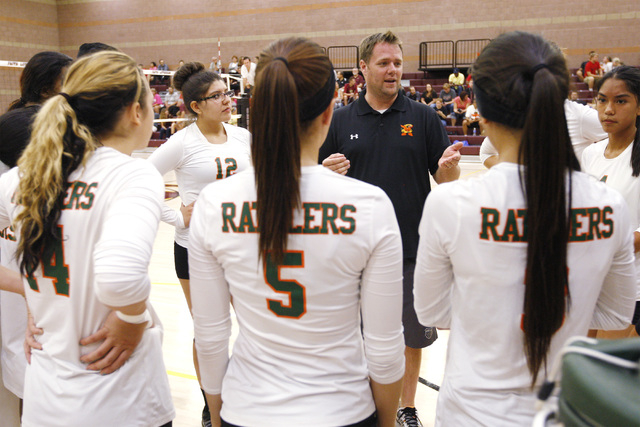 Mojave Girls Volleyball coach Erik Davis talks to his players between games against Faith Lutheran Thursday, Sept. 18, 2014 at Faith Lutheran in Las Vegas. (Sam Morris/Las Vegas Review-Journal)