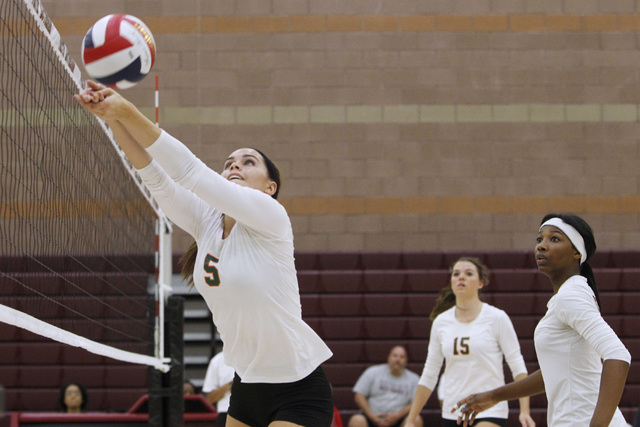 Mojave Girls Volleyball player RayEna Rael sets the ball during their game against Faith Lutheran Thursday, Sept. 18, 2014 at Faith Lutheran in Las Vegas. (Sam Morris/Las Vegas Review-Journal)
