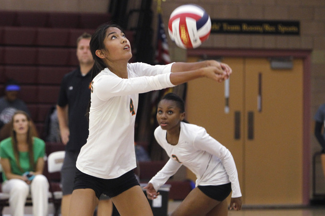 Mojave Girls Volleyball player Carissa Limtiaco digs a ball during their game against Faith Lutheran Thursday, Sept. 18, 2014 at Faith Lutheran in Las Vegas. (Sam Morris/Las Vegas Review-Journal)