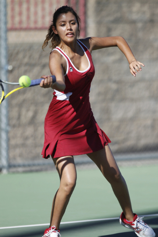 Western's senior Nathalia Luna, 18, returns the ball during her match against Del Sol's Alina Marruffo, 16, at Western High School in Las Vegas Wednesday, Sept. 3, 2014. Luna is the only returning ...