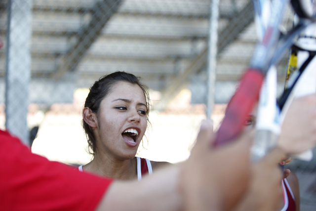 Western's senior Nathalia Luna, 18, huddles with her team prior to her match at Western High School in Las Vegas Wednesday, Sept. 3, 2014. Luna is the only returning girl's tennis player from the  ...