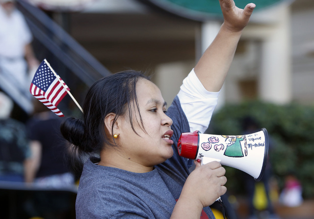 Beauleen Manuel, a worker at KFC, shouts slogans as she protests with other workers from restaurants including McDonald's, Burger King, Wendy's and KFC, outside McDonald's near Harrah's on the Las ...