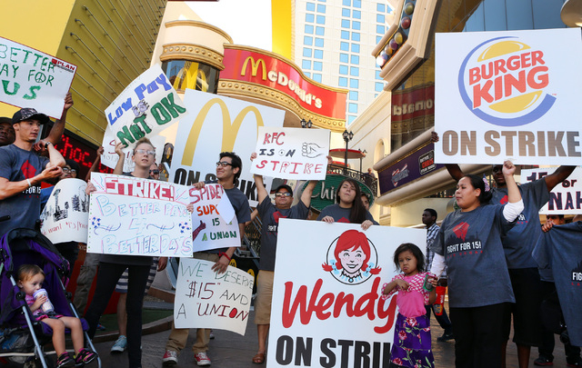 Workers from restaurants including McDonald's, Burger King, Wendy's and KFC, protest outside McDonald's near Harrah's on the Las Vegas Strip on Thursday, Sept. 4, 2014. They joined counterparts ac ...
