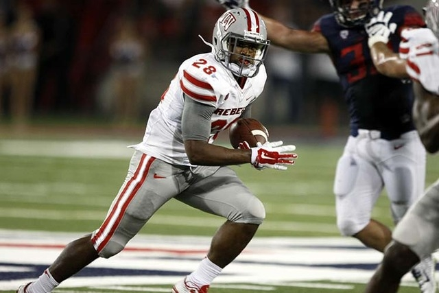 UNLV running back Keith Whitely (28) runs the ball against Arizona during the first half of an NCAA college football game, Friday, Aug. 29, 2014, in Tucson, Ariz. (AP Photo/Rick Scuteri)