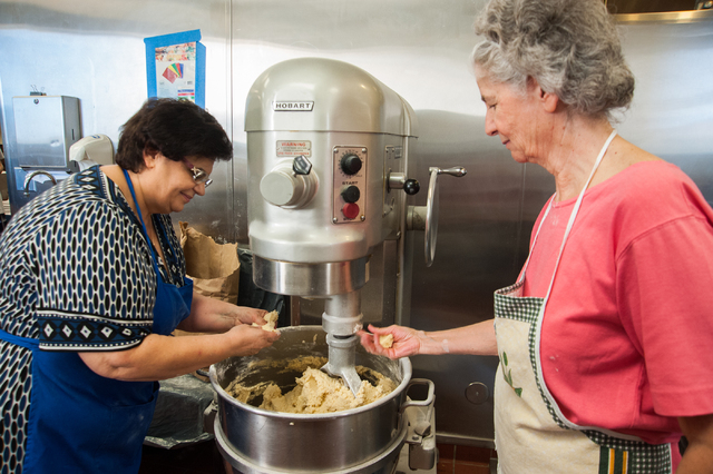 Volunteers from left, Kiki Mavrantonis and Sophia Leonis mix up cookie dough for the upcoming Greek Food Festival where the percentage of the proceeds will go to St. John the Baptist Church on 530 ...
