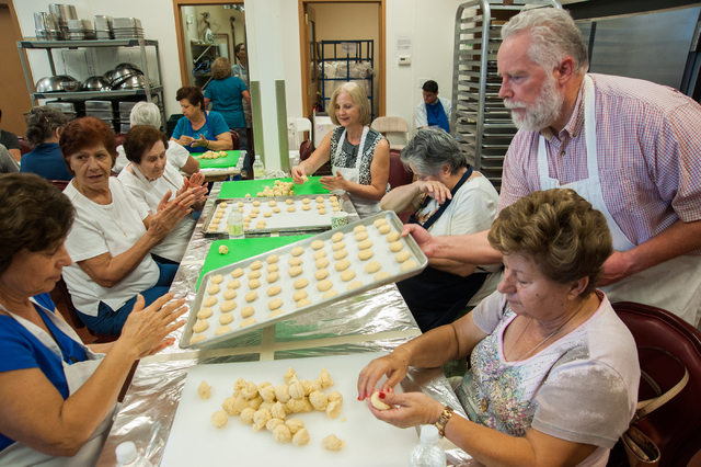 Volunteers make kourambiedes a greek cookie for the upcoming Greek Food Festival where the percentage of the proceeds will go to St. John the Baptist Church on 5300 El Camino Road in Las Vegas fro ...