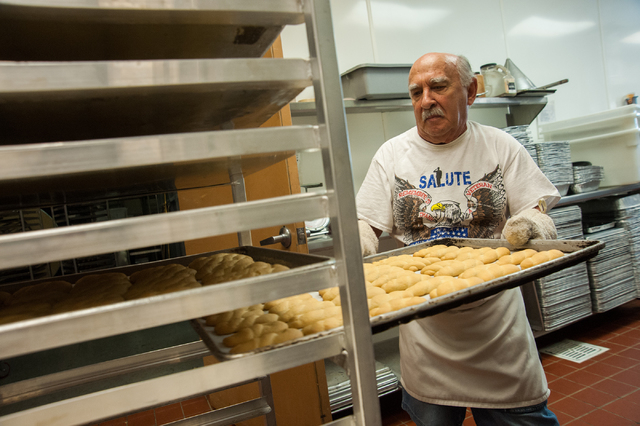 Savva Savvas puts a tray of Koulourakia, aka greek cookies away to cool for the upcoming Greek Food Festival where the percentage of the proceeds will go to St. John the Baptist Church on 5300 El  ...