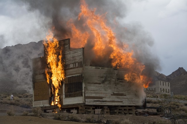 The Mercantile building near the Bottle House in Rhyolite burns after being stuck by lightning shortly after 3 p.m. on Saturday, Sept. 20, 2014. The Beatty Volunteer Fire Department was not yet on ...