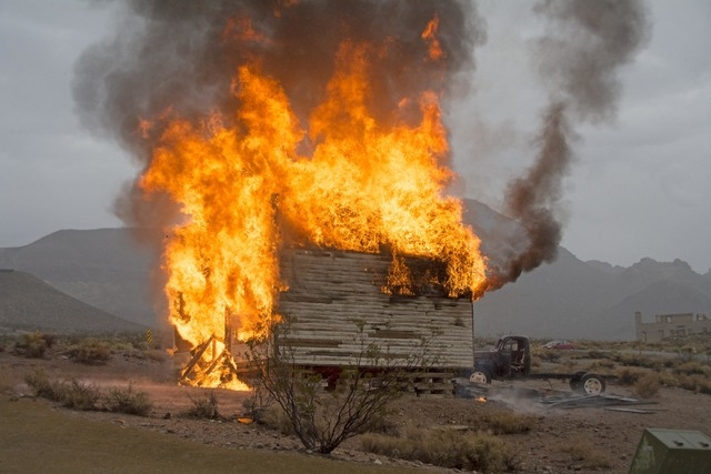 The Mercantile building near the Bottle House in Rhyolite burns after being stuck by lightning shortly after 3 p.m. on Saturday, Sept. 20,2014. The Beatty Volunteer Fire Department was not yet on  ...