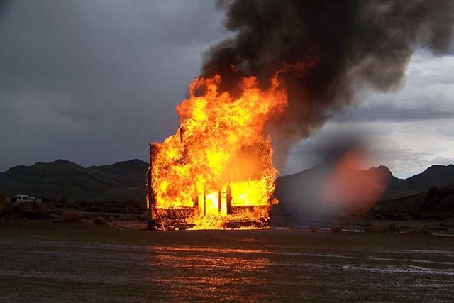 The Mercantile building near the Bottle House in Rhyolite burns after being stuck by lightning shortly after 3 p.m. on Saturday, Sept. 20, 2014. (Mark Holloway/submitted via At The Scene)