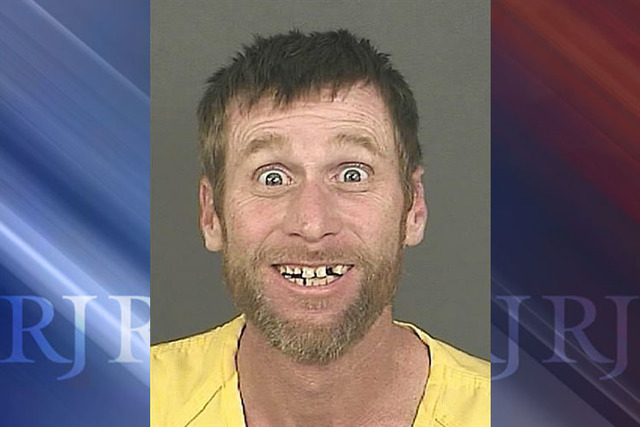 A Sept. 23, 2014 photo provided by the Denver District Attorneys Office shows Michael Whitington with a broad, toothy smile and eyes open wide after his Sept. 23, 2014 arrest in Denver. (AP Photo/ ...
