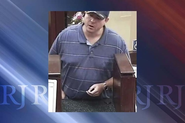 Police are looking for a suspect in a bank robbery inside a grocery store near Eastern Avenue and Windmill Lane. The male suspect is about 35 years old, 6-foot-3, 280 pounds with a lazy eye. He wa ...