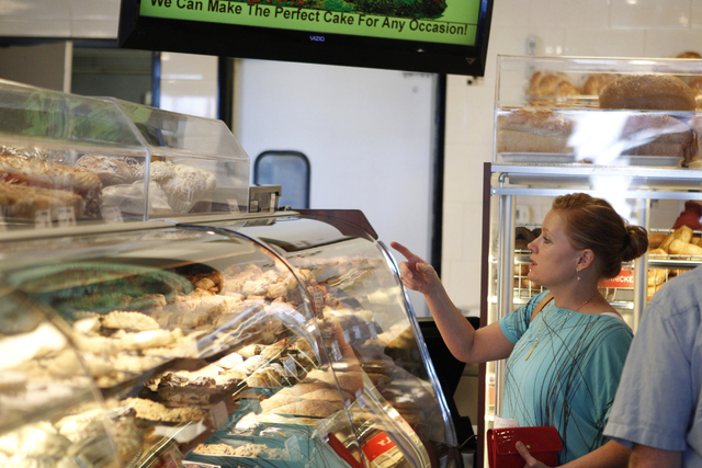 Camila Cheater looks at baked goods on display for the Jewish holiday Rosh Hashanah at Bagel Cafe, 301 N. Buffalo Drive, in Las Vegas Wednesday, Sept. 17, 2014. (Erik Verduzco/Las Vegas Review-Jou ...