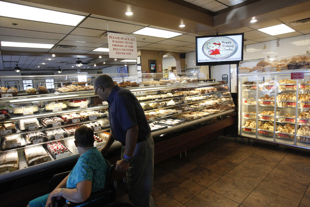 Customers browse the baked goods counter at Bagel Cafe, 301 N. Buffalo Drive, in Las Vegas Wednesday, Sept. 17, 2014. Bagel Cafe is selling baked goods for the Jewish holiday Rosh Hashanah. (Erik  ...