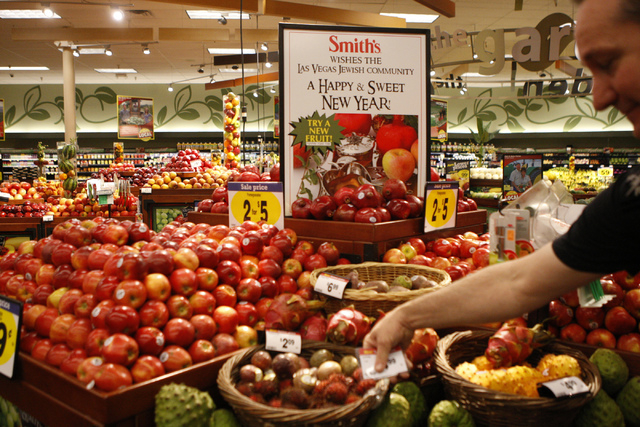 Store director Kevin Hollowinski shows fruits that include apples and pomegranates as part of their Kosher Experience at Smith's, 2211 N. Rampart Blvd., in Las Vegas Thursday, Sept. 18, 2014. (Eri ...