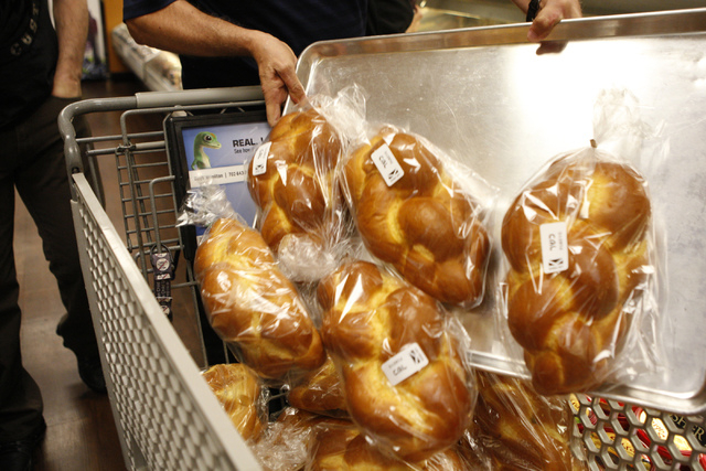 Peter Randazzo loads his cart with challah bread for students at his Hebrew school, Adelson High School, at Smith's , 2211 N. Rampart Blvd., in Las Vegas Thursday, Sept. 18, 2014. The store is the ...