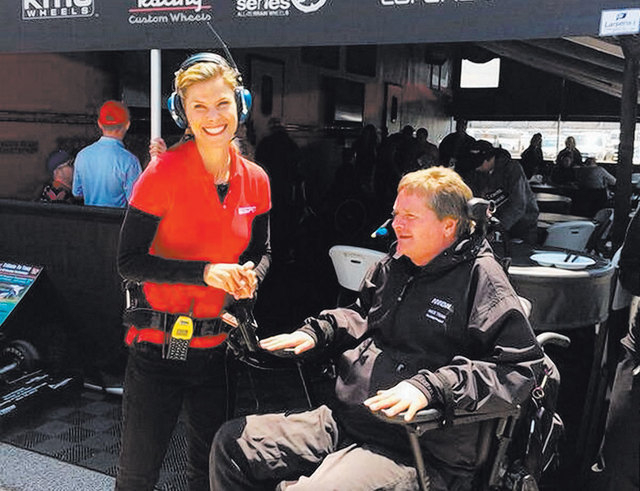 Indy car owner Sam Schmidt, right, who lives at Lake Las Vegas, talks with ABC's Jamie Little of Henderson at Indianapolis Motor Speedway. (Courtesy)