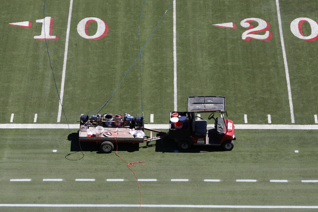The Sam Boyd Stadium field is seen during a tour Tuesday, Sept. 2, 2014. The stadium recently installed new improvements to the stadium that include a new scoreboard, paint and revenue markers. (E ...