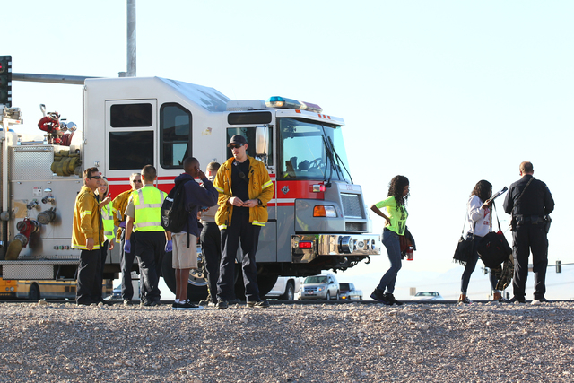 Students involved in a school bus crash, which included another vehicle, are seen as Nevada Highway Patrol officers and Las Vegas Fire and Rescue officials respond at the 215 Beltway and Lamb Boul ...