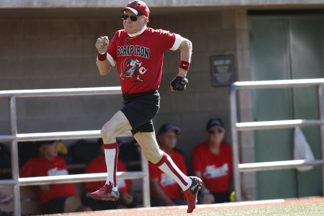 Scrap Iron's Fred Mattos (0) sprints home for a run during their seeding game against Hawaii Seniors in the Las Vegas Senior Softball Association World Masters Championship at Crosley Field at the ...