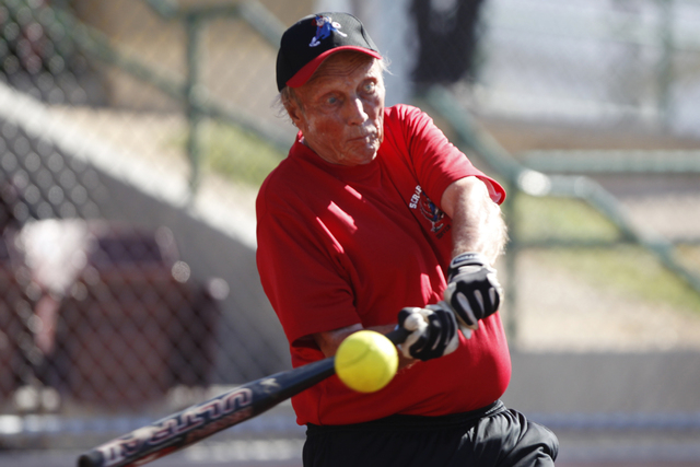 Scrap Iron's Paul Janke (42) swings the bat during their seeding game against Hawaii Seniors in the Las Vegas Senior Softball Association World Masters Championship at Crosley Field at the Big Lea ...