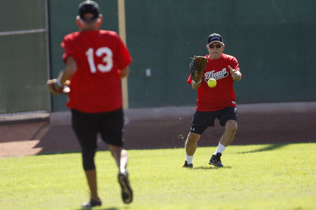 Hawaii Seniors Jim Hildenbrand (11) goes for the ball in their seeding game against Scrap Iron in the Las Vegas Senior Softball Association World Masters Championship at Crosley Field at the Big L ...