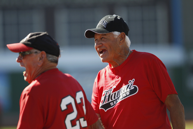 Scrap Iron's Richard Skinner (23), left, and Hawaii Seniors Ray Flores (6) share a laugh on third base during seeding game in the Las Vegas Senior Softball Association World Masters Championship a ...