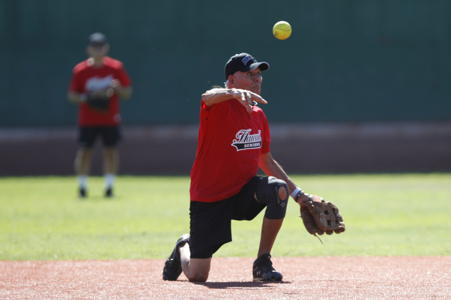 Hawaii Seniors Francis Lum (13) makes a throw to second base for an out during their seeding game against Scrap Iron in the Las Vegas Senior Softball Association World Masters Championship at Cros ...