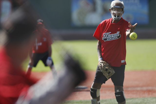 Hawaii Seniors Leroy Pulawa (5) pitches the ball against Scrap Iron during the seeding game in the Las Vegas Senior Softball Association World Masters Championship at Crosley Field at the Big Leag ...
