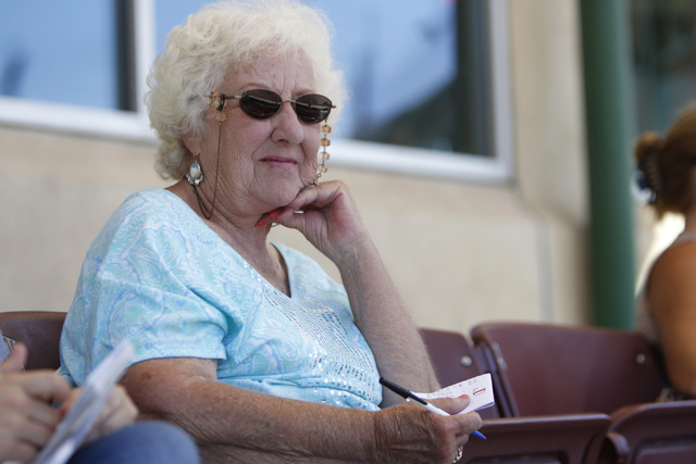 Donna Dean, 79,  watches his husband Richard Skinner, 83, play for Scrap Iron in their seeding game against Hawaii Seniors in the Las Vegas Senior Softball Association World Masters Championship a ...