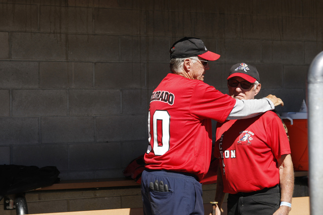 Mike Kirkpatrick (30), left, and Wes Horen (24), talk to each other in the dugout during their seeding game against Hawaii Seniors in the Las Vegas Senior Softball Association World Masters Champi ...