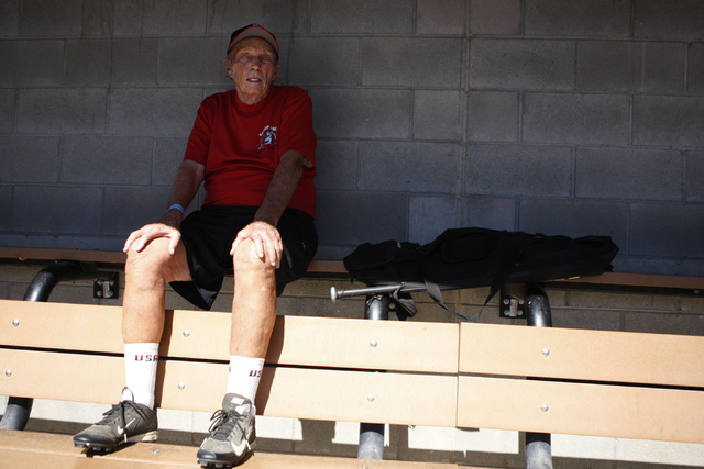Scrap Iron's Paul Janke (42) watches his team take the field from the dugout during their seeding game against Hawaii Seniors in the Las Vegas Senior Softball Association World Masters Championshi ...